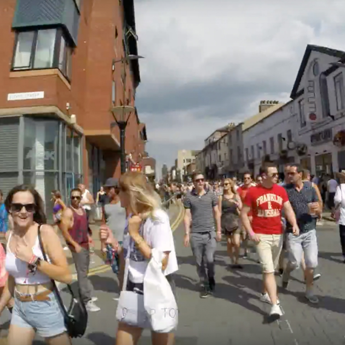 Revellers on the streets during Tramlines urban festival